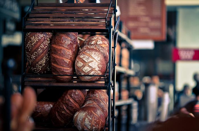 Freshly baked loaves displayed on shelves at Boudin Sourdough Bakery & Cafe