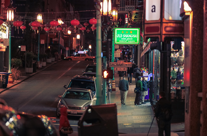 Pedestrians at the corner of Grant Avenue and Sacramento Street in Chinatown