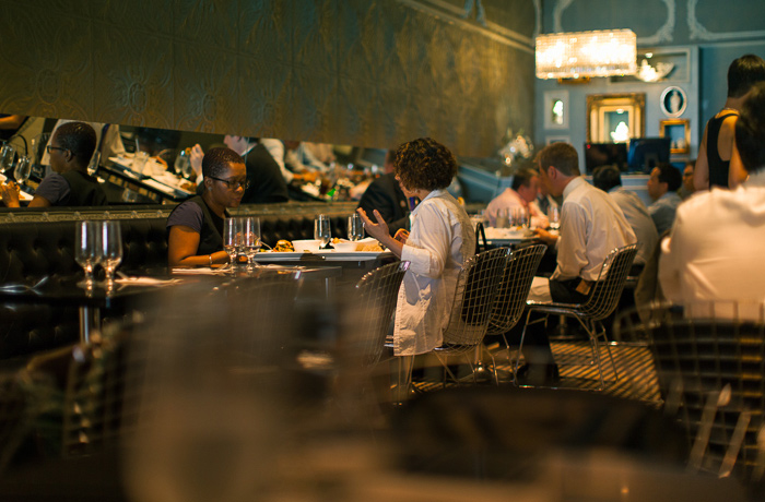 Diners inside the cozy interior of Room Service, a Thai restaurant located in Chelsea, Manhattan