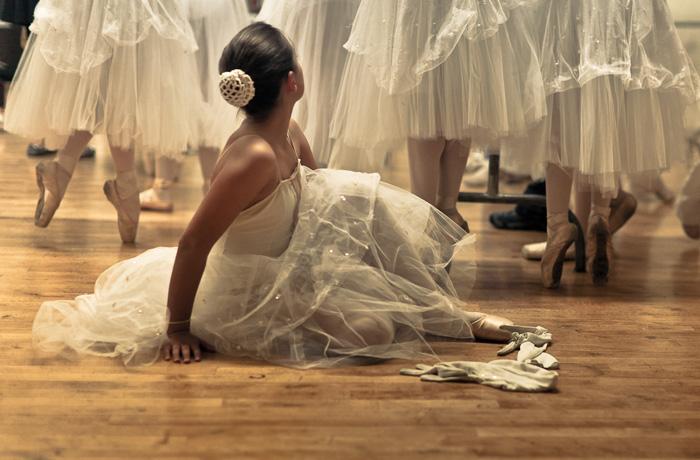 Ballerina Adjusting Her Slipper