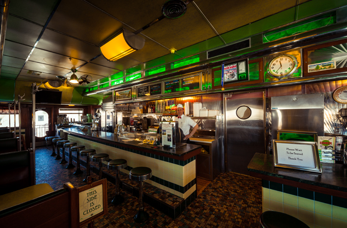 The interior of the diner standing at the entrance looking in