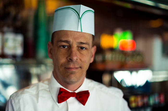 Petey in his vintage white soda jerk shirt, red bow tie and paper hat
