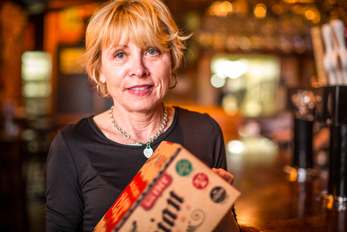 """Owner  Helen Petras holding the new variety pack """"Old School Brew 12er"""""""