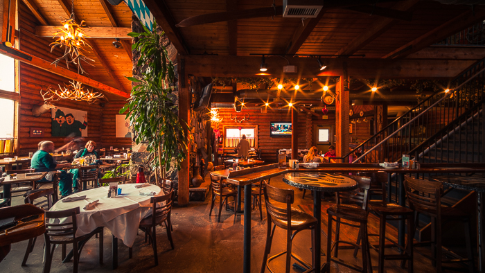 The rustic interior of the restaurant brings to mind the famous mountain lodges of the Czech Republic