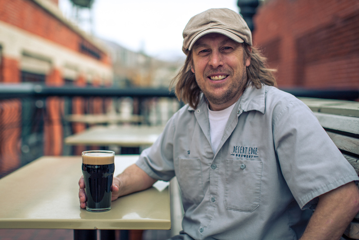Head Brewer Chris Haas taking a moment to relax in the outside balcony of The Pub in Trolley Square
