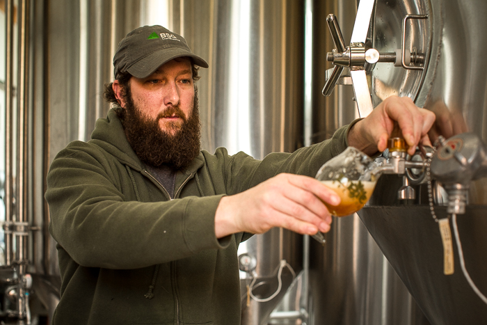Brew Master Kevin Crompton of Epic Brewing Company checking a new batch of the Imperial IPA