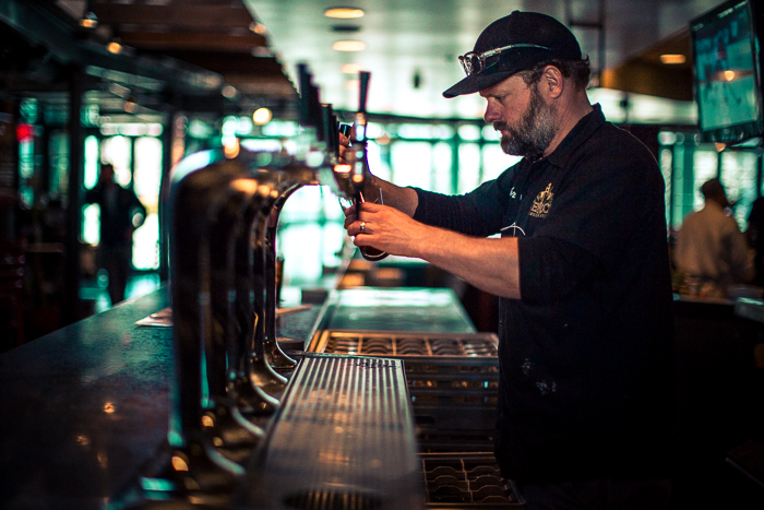 "Brewer Chris Harlin of Red Rock pouring a tall glass of ""Opie"" Red Ale"