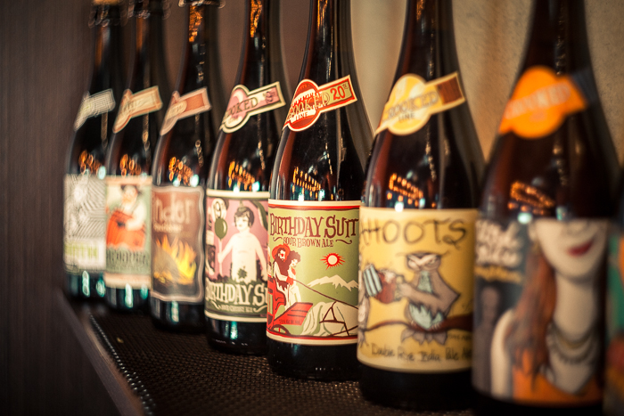 A line of colorful, illustrative labels featuring local artists